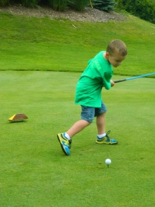 Hit off a golf ball at the start of his cousin Ellie's Par-tee for CURED.